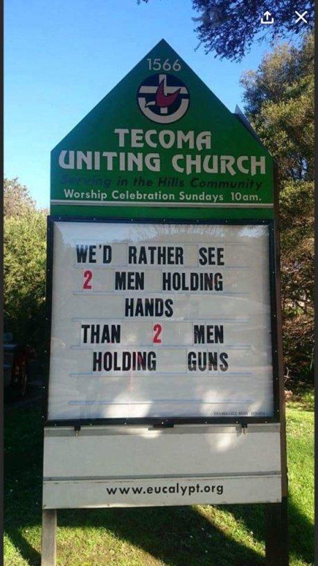 sign2menholdinghands